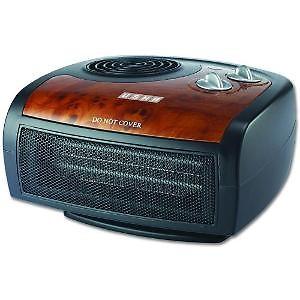 Usha FH 1212 PTC Fan Heater (1212 PTC) 1500-Watt with Adjustable Thermostat (Black/Brown) Fan Room Heater price in India.